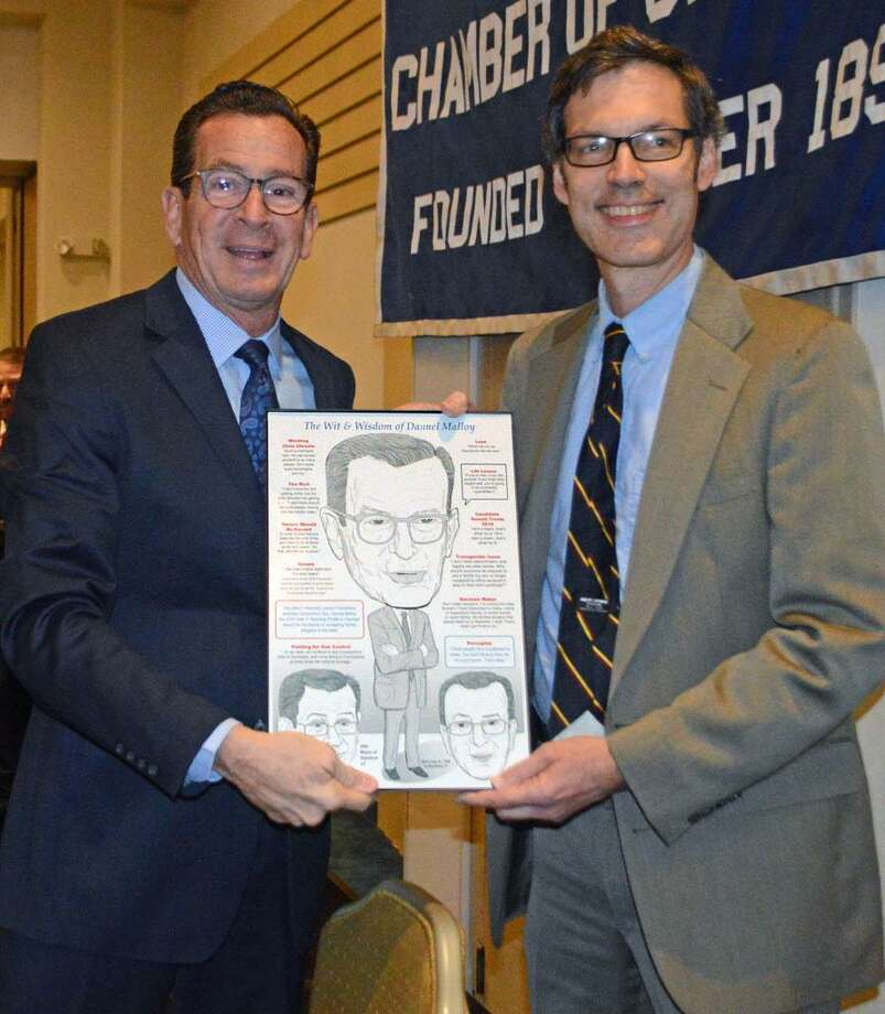Artist Robert Carley of Darien, right, presented Gov. Dannel P. Malloy with a caricature of himself during the recent Middlesex County Chamber of Commerce breakfast at the Radisson Cromwell, where Malloy was guest speaker. Photo: Contributed Photo