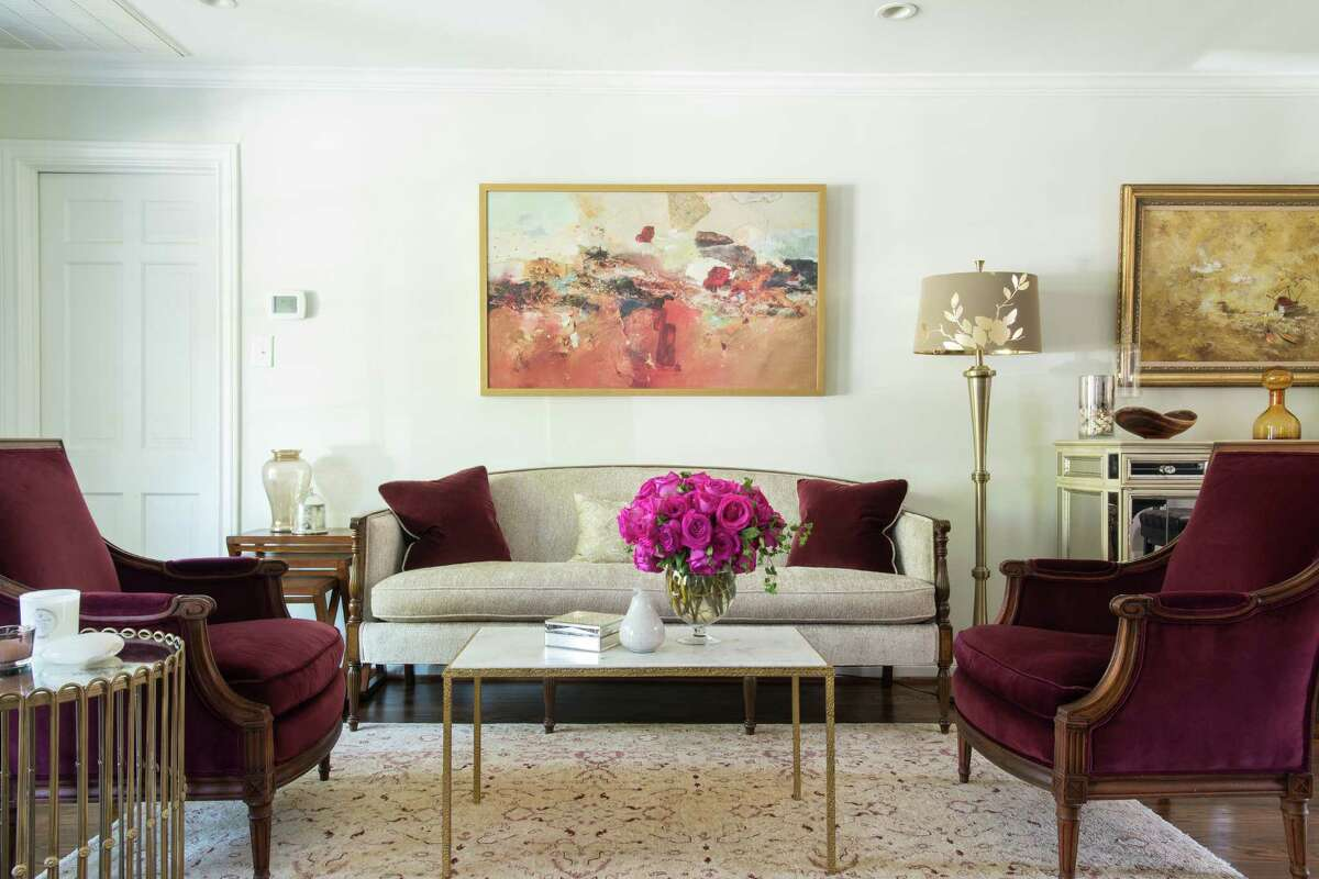 2. The sofa and armchairs in this West U home where two physicians live weren't bought new. Their interior designer found themin a resale shop and had them reupholstered. Because they were vintage, they were sized for smaller homes such as the bungalow this family lived in.