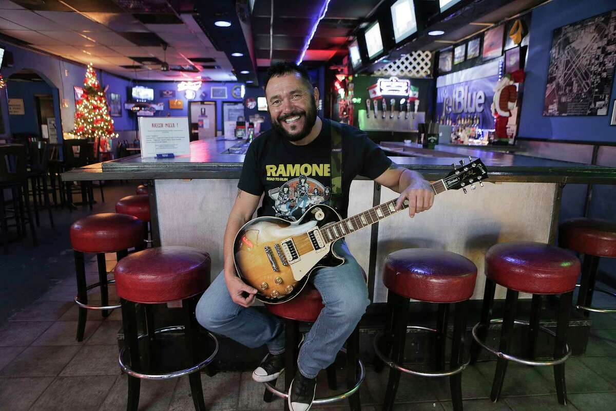 Charlie Wells Castellano, co-owner and bartender of Cockpit Bar & Grill, with his 2013 Gibosn Les Paul Standard, for a profile on Friday, Dec. 15, 2017, in Houston. ( Elizabeth Conley / Houston Chronicle )