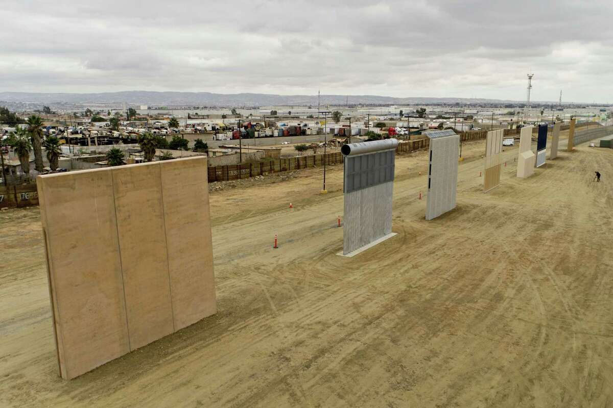 Prototype U.S.-Mexico border walls stand in this aerial photograph taken over San Diego, California, U.S., on Monday, Oct. 30, 2017. President Donald Trump has directed the Department of Homeland Security to carry out one of his more prominent campaign promises: to build a wall on the U.S. border with Mexico. In October, signs of progress emerged-a handful of 30-foot-tall prototypes at a construction site near San Diego. Photographer: Daniel Acker/Bloomberg