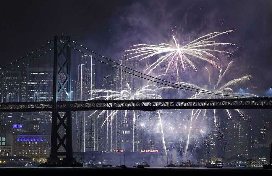 Fireworks light up over the San Francisco Bay as New Year's celebrations rang in 2017 in San Francisco, Calif., on Sunday, January 1, 2017. While no rain is in the forecast, cloudy skies forecast for Saturday night could obscure this year's fireworks show. Photo: Carlos Avila Gonzalez / The Chronicle / /