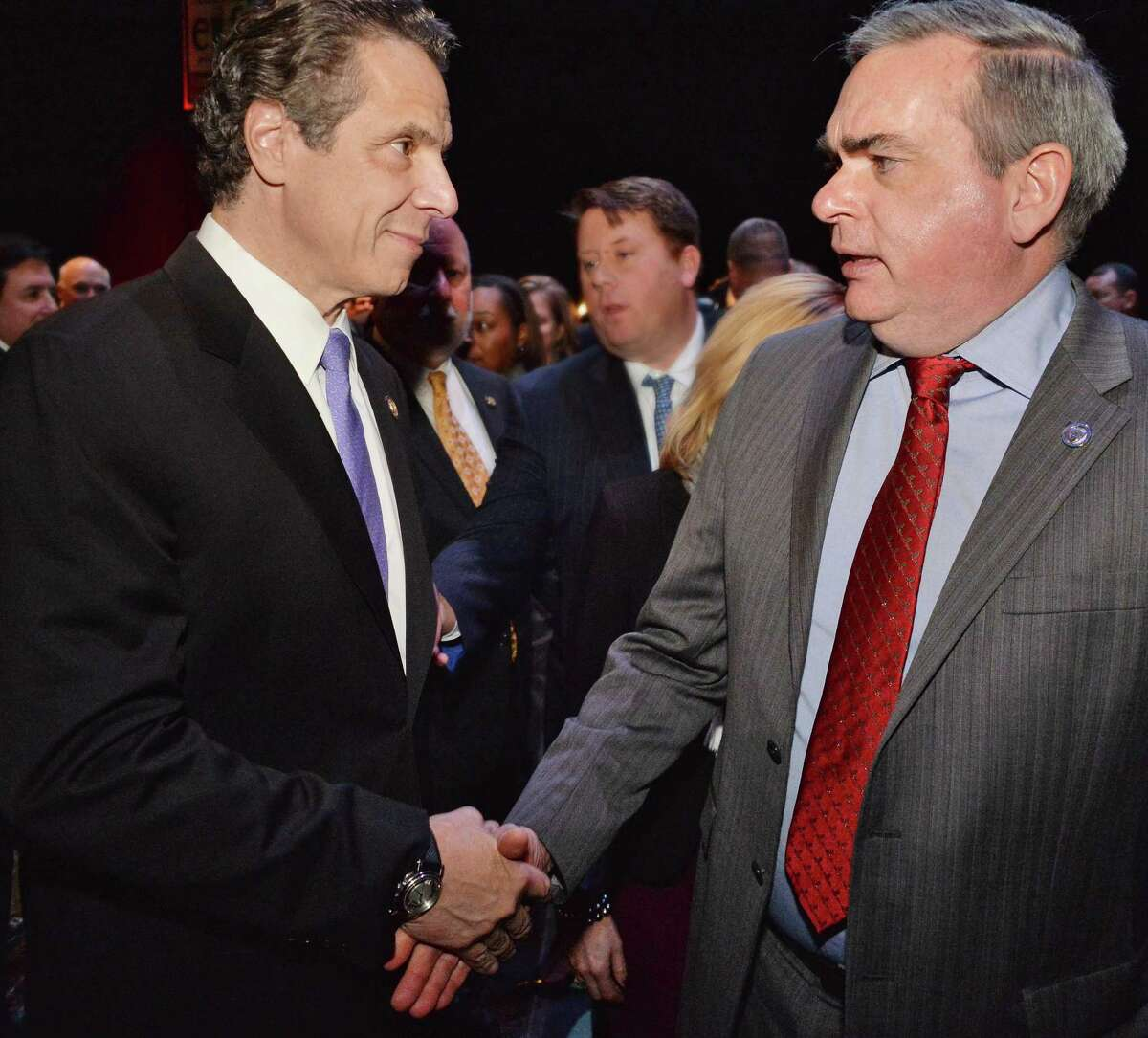 Gov. Andrew Cuomo, left, and Schenectady Mayor Gary McCarthy shake hands during a celebration of the selection of Schenectady as the Capital Region site for the Rivers Casino at Mohawk Harbor on Thursday, Dec. 18, 2014, in the GE Theatre at Proctors in Schenectady, N.Y. (John Carl D'Annibale / Times Union)
