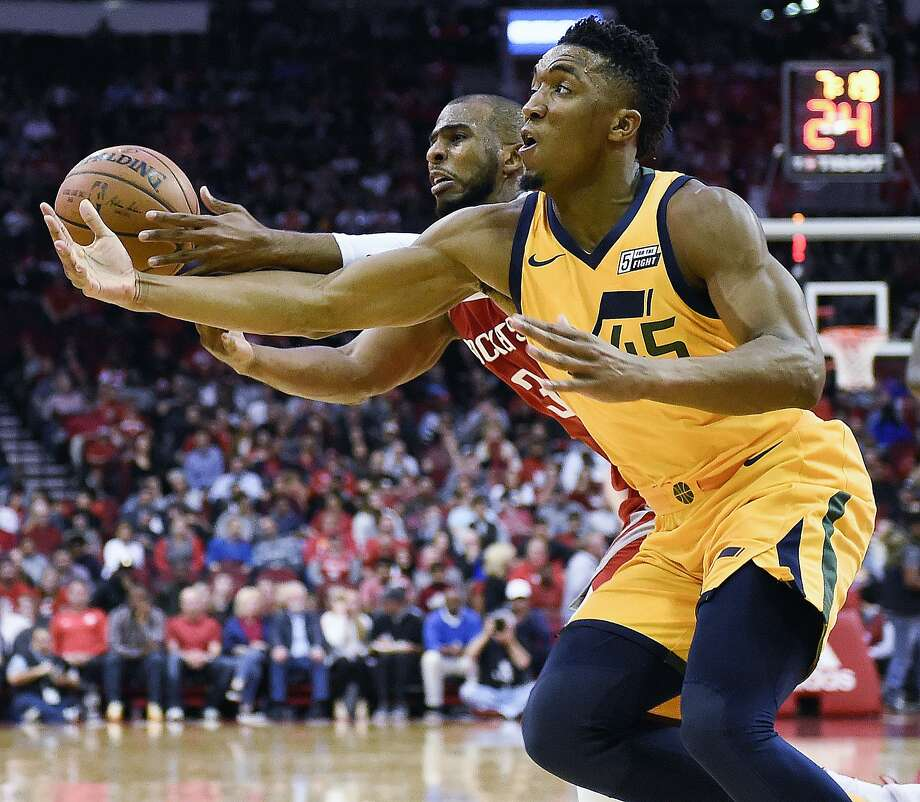 Utah Jazz guard Donovan Mitchell, right, and Houston Rockets guard Chris Paul chase a loose ball during the second half of an NBA basketball game, Monday, Dec. 18, 2017, in Houston. Houston won the game 120-99. (AP Photo/Eric Christian Smith) Photo: Eric Christian Smith, Associated Press