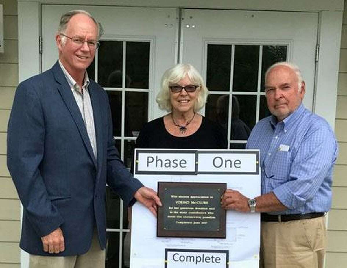"""Bridgewater Senior Center has completed the first phase of an anticipated three-step expansion program with the recent completion of an enlarged entryway. This new portico was funded in part by the Town of Bridgewater, the residents of Bridgewater, the senior center and in particular by multi-year donations from Yoriko McClure. """"We look forward to a bigger and better senior center to help meet the increasing needs of our senior citizens,"""" said First Selectman Curtis Read, left, who is shown with center director Marilyn Curtin and Ken Lightcap, chairman of the board of directors."""