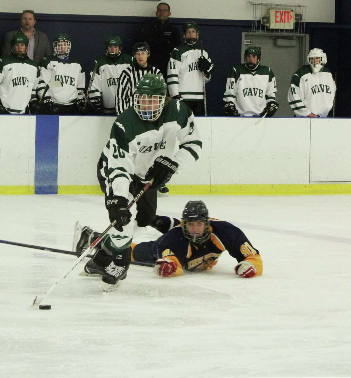 Senior Ben Paquin checks an East Haven opponent to get the puck.
