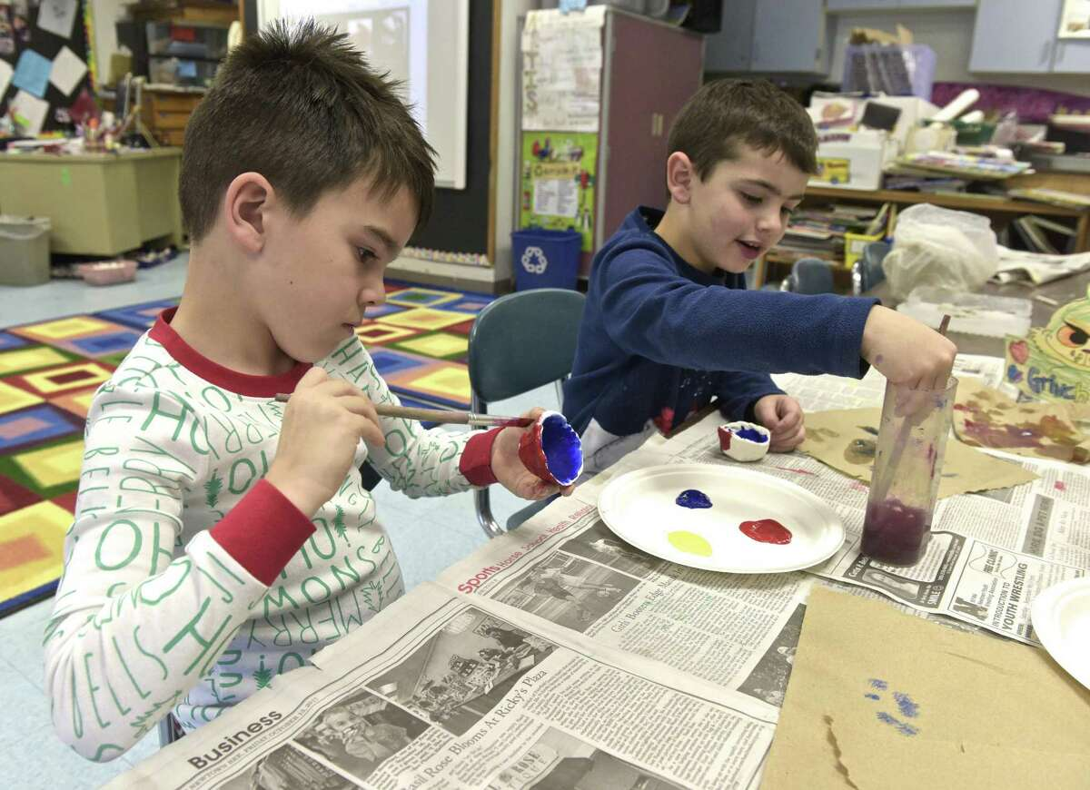 Maddox Colorusso, left, and Lane Bell, both in kindergarten, work on their art projects at Hill & Plain Elementary School in New Milford .