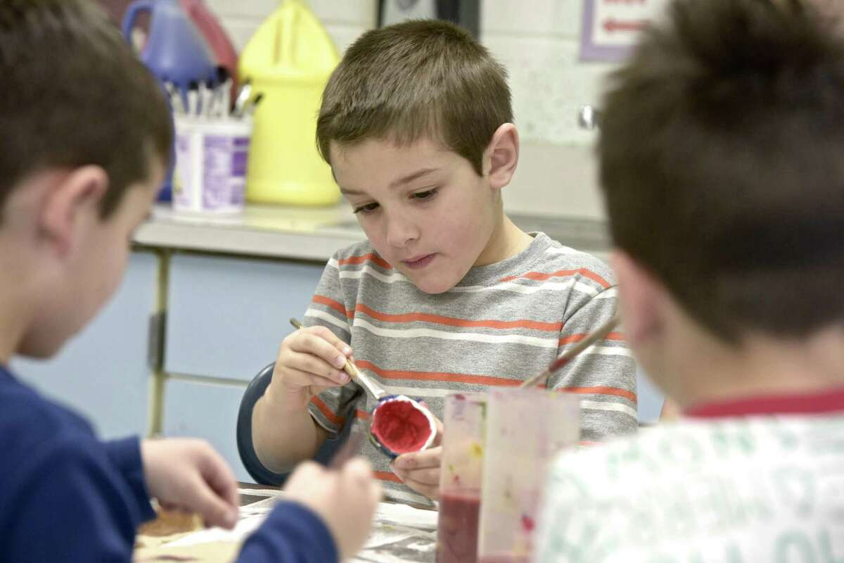 Kindergartener Alessandro Romano, works on an art project at Hill & Plain Elementary School. The New Milford school system has created a new art curriculum meets new standards.