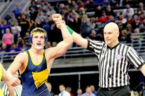 """1. Bad Axe's Dylan Smith wins state wrestling championship    In March, Bad Axe grappler Dylan Smith made history. He became the first Tribune area wrestler in over a decade to win a state wrestling championship.    His 3-2 victory over Bronson's David Erwin secured Bad Axe's first wrestling state championship since 1991.     """"The atmosphere was amazing and the hard work really paid off,"""" said Smith. """"Off the mat, it was easier to see how I really felt. I just thanked my coaches for all the work they put into it.""""   p.p1 {margin: 0.0px 0.0px 0.0px 0.0px; font: 18.0px Helvetica} span.s1 {font-kerning: none}   Added Bad Axe coach Adam Hollingsworth: """"It was just pure joy and excitement,"""" he said. """"It was just really, really emotional. To feel it all come together, is hard to describe. It's an unbelievable feeling."""""""
