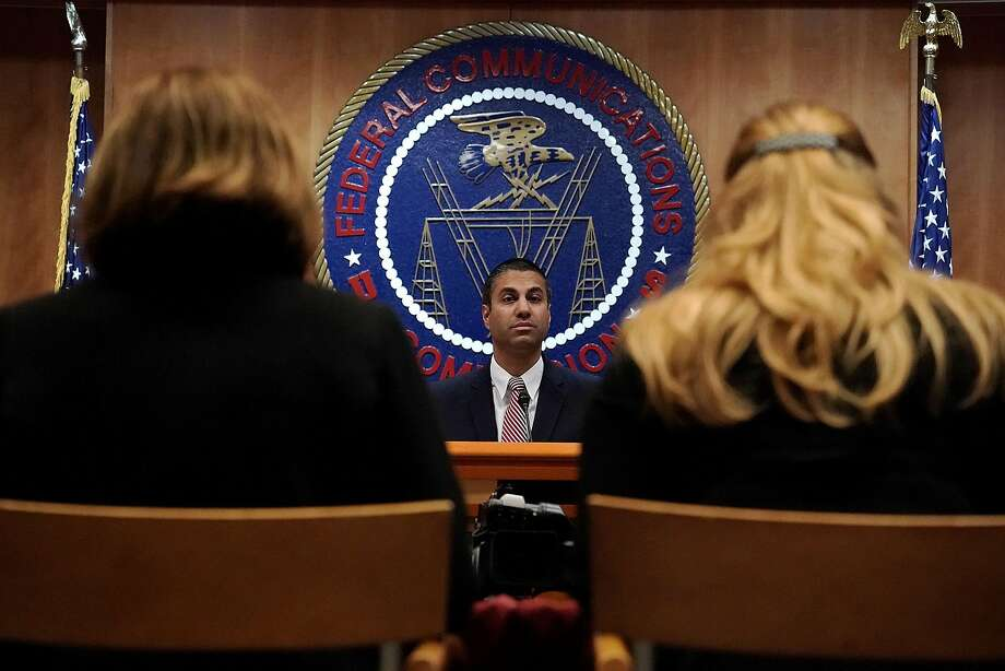 WASHINGTON, DC - DECEMBER 14:  Federal Communications Commission Chairman Ajit Pai (C) listens during a commission meeting December 14, 2017 in Washington, DC. FCC has voted to repeal its net neutrality rules at the meeting.  (Photo by Alex Wong/Getty Images) Photo: Alex Wong, Getty Images