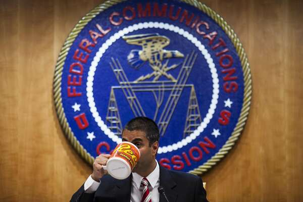 Bloomberg Best of the Year 2017: Ajit Pai, chairman of the Federal Communications Commission (FCC), drinks from an oversized coffee mug during an open meeting in Washington, D.C., U.S., on Thursday, Nov. 16, 2017. Photographer: Zach Gibson/Bloomberg