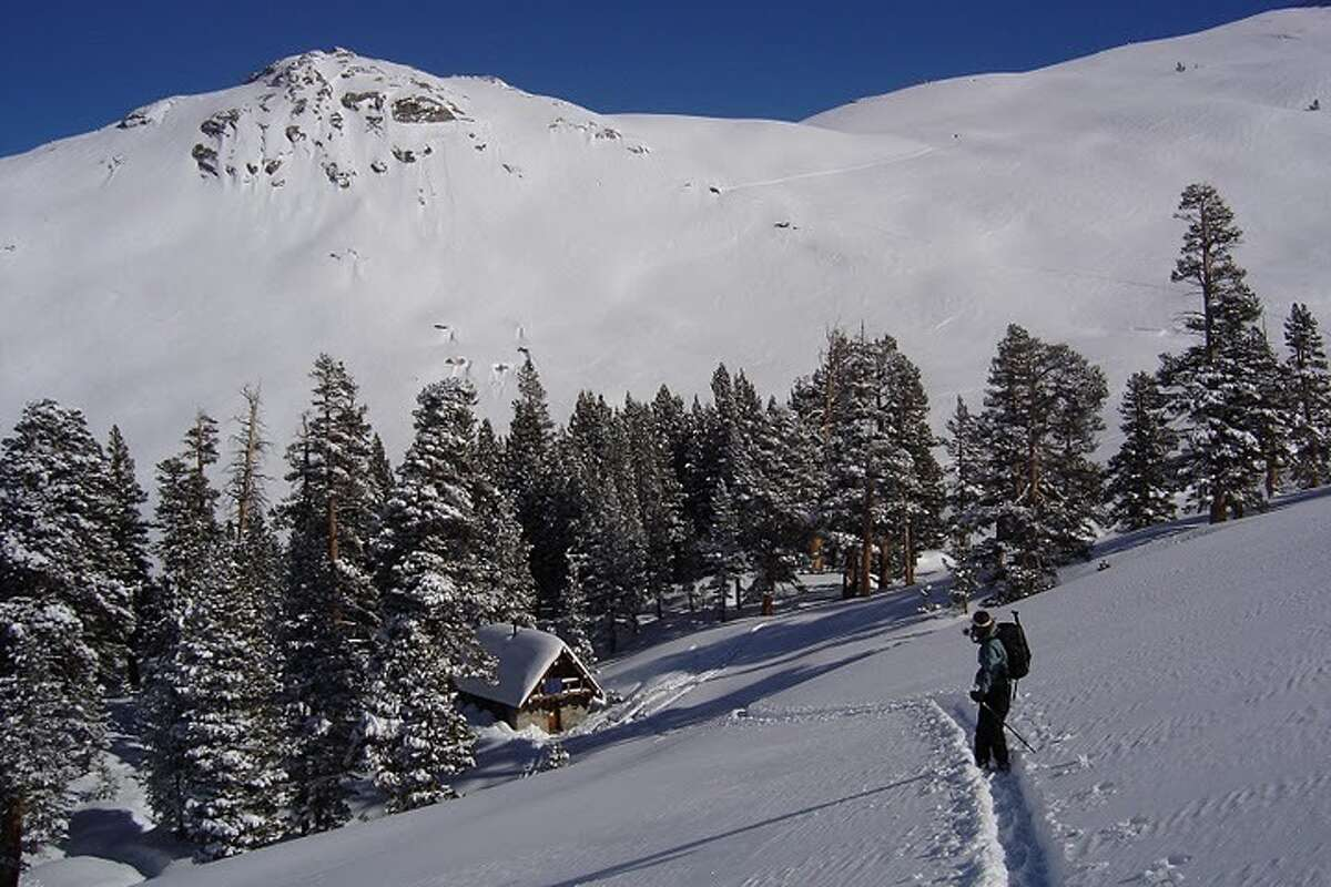 It isn't easy to reach the Pear Lake Winter Hut. You start out at 7,200 feet in at Wolverton and ski or snowshoe six miles up to 9,200 feet.