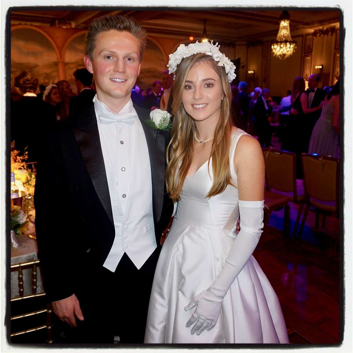 Escort William Boyd and debutante Catherine Bellis at the 76th Cotillion at the Palace Hotel. Dec. 22, 2013.