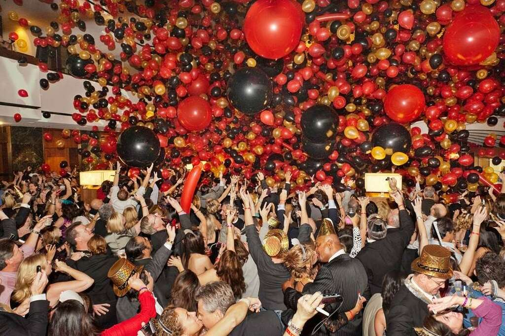 The Ruby Red New Year''s Eve Party at the Hyatt Regency Houston features a midnight cascade of 50,000 red balloons, two live bands, DJ, party favors and a drawing. Photo: Courtesy Photo