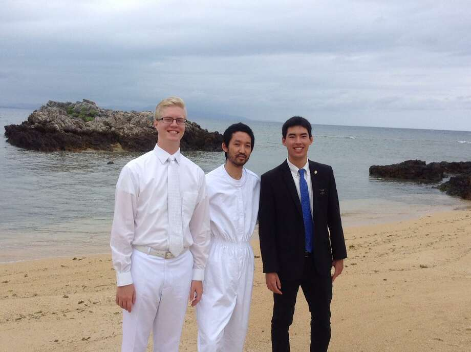Brandon Malone (far right) is pictured on Ishigaki Island, about 300 kilometers off the north eastern coast of Taiwan.His companion, Elder Clay (left) is about tobaptize Diego Yonamine in the South China Sea. Photo: Courtesy