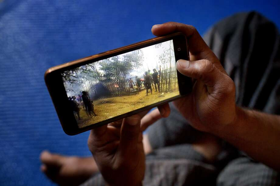 Mujibullah, 22, a Rohingya refugee, watches a video he shot in Myanmar before crossing over into Bangladesh and winding up at a camp in Kutupalong. Photo: A.M. Ahad, Associated Press
