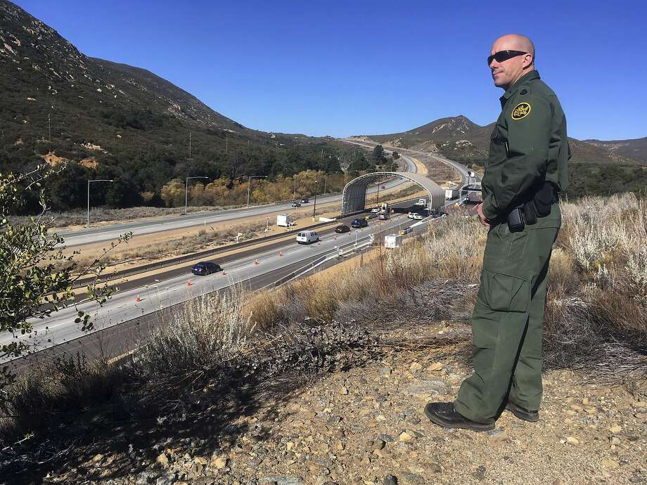 Border Patrol agent Troy Hunt looks over Pine Valley checkpoint along the main route from Arizona to San Diego. Marijuana possession will still be prohibited at such border crossings. Photo: Elliott Spagat, Associated Press