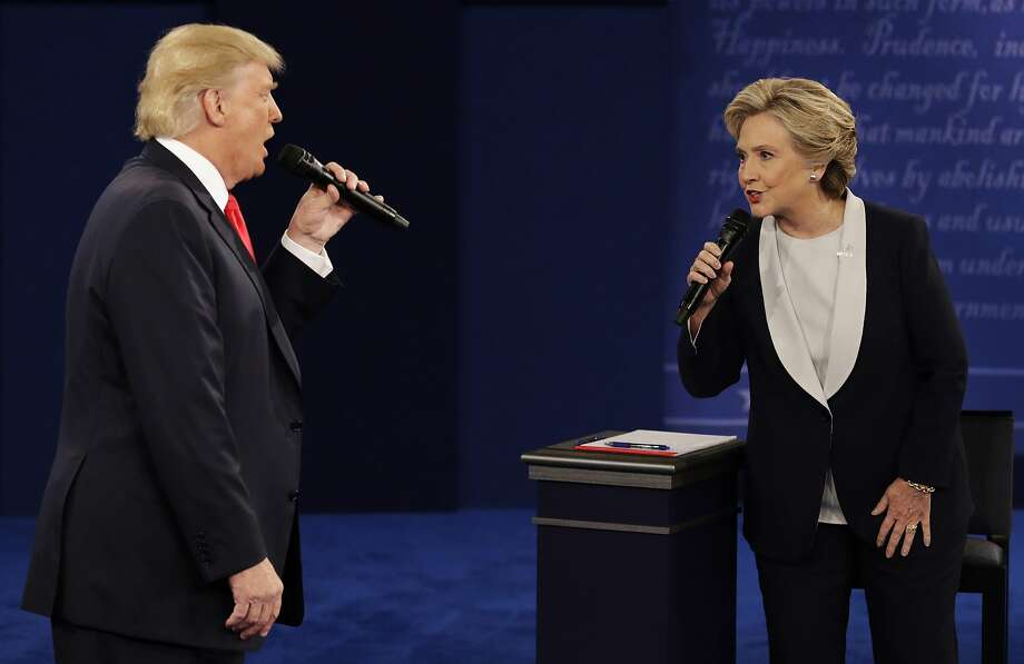 Republican presidential nominee Donald Trump and Democratic presidential nominee Hillary Clinton speak during the second presidential debate at Washington University in St. Louis in October 2016. A year later, polling shows both of them deeply unpopular. Photo: John Locher, Associated Press