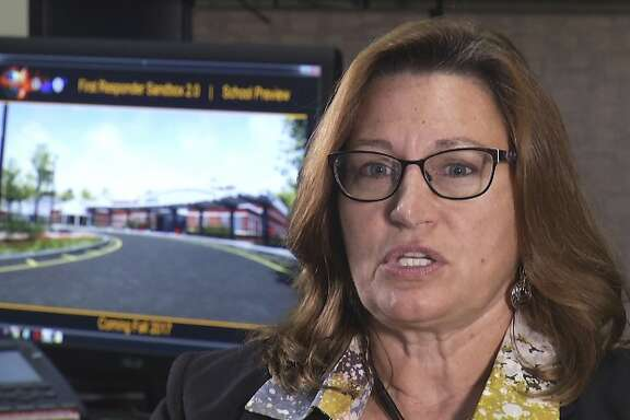 In this undated frame from video, Tamara Griffith, a chief engineer for a computer-based simulator that can be used to train people on how to react during an active shooter situation, says the goal is to teach teachers to respond as first responders. Using cutting-edge video game technology and animation, the U.S. Army and Homeland Security Department developed a computer-based simulator that can train everyone from teachers to first responders on how to react to an active shooter scenario. The training center is housed at the University of Central Florida in Orlando and offers numerous role-playing opportunities that can be used to train anyone in the world with a computer. (AP Photo/Joshua Replogle)