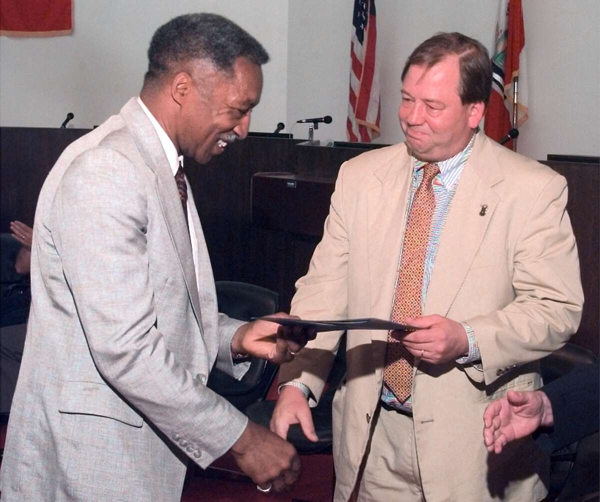 Times Union photo by JAMES GOOLSBY-JUN. 17, 1998-(RENTU)-(L. TO R.)-REV. CORNELIUS CLARK, PASTOR OF THE HOLY SERENITY CHURCH OF GOD AND CHRIST. RECEIVES CERTIFICATE AS A GRADUATE OF THE TROY CITIZENS POLICE ACADEMY, FROM TROY MAYOR, MARK PATTISON. AT GRADUATION CEREMONIES HELD IN THE TROY CITY HALL COUNCIL CHAMBERS.