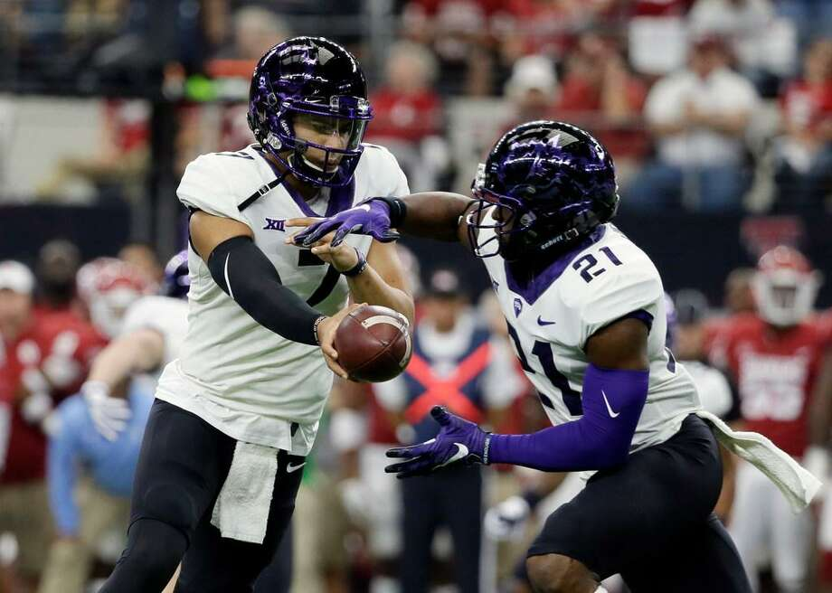 TCU quarterback Kenny Hill (7) hands the ball off to running back Kyle Hicks (21) in the first half of the Big 12 Conference championship NCAA college football game Dec. 2, 2017, in Arlington, Texas. Photo: Tony Gutierrez /AP Photo