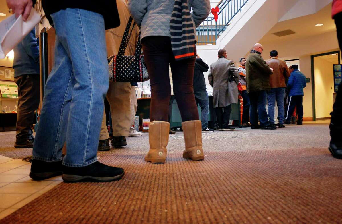 Residents wait in line to pay their 2018 local taxes at the Niskayuna Town Hall on Wednesday, Dec. 27, 2017, in Niskayuna, N.Y. (Paul Buckowski / Times Union)