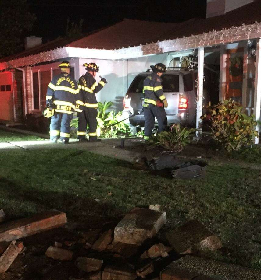 An SUV crashed through the front of a house Tuesday evening in Santa Clara after running a stop sign, officials said.