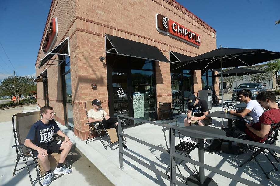 """Chipotle fans Austin Lum, Ryan Buford, Chad Willis, Aston Jones, and Walee Sultan of Vidor talk as they await the opening of Chipotle in Beaumont Thursday morning. The group say they have been making the trek to the Port Arthur Chipotle at least twice a week since that venue opened in December 2015, and are glad to have the popular Mexican chain even closer to home. They were rewarded for being first with their orders served at no charge. Lum says their love of Chipolte is """"that medium sauce. You get lost in the sauce."""" Photo taken Thursday, March 23, 2017 Kim Brent/The Enterprise Photo: Kim Brent, Beaumont Enterprise"""