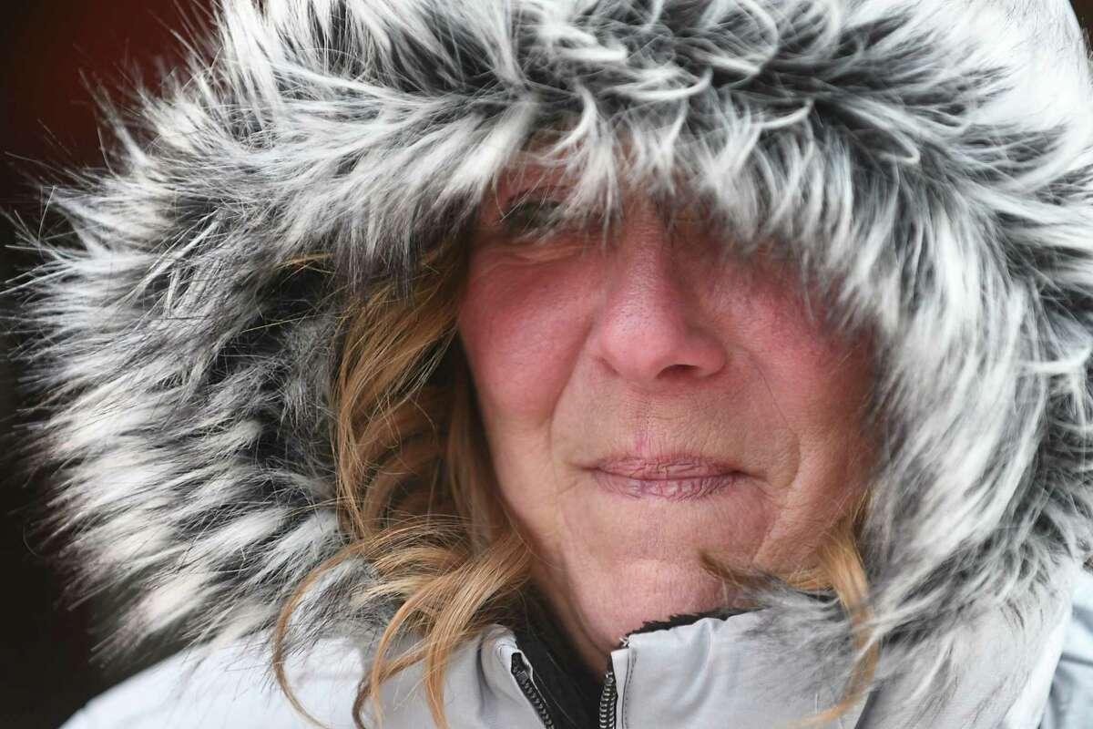 Darci Kane of Waterford tries to stay warm on her break outside the Troy Atrium on Wednesday, Dec. 27, 2017 in Troy, N.Y. (Lori Van Buren / Times Union)