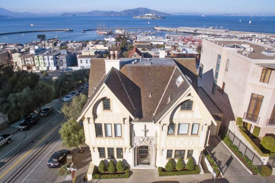 Right next to the cable car track in Russian Hill sits 898 Francisco St., a 1914 Gothic Tudor formerly owned by Face/Off and Con Air star Nicolas Cage. Photo: Sotheby's