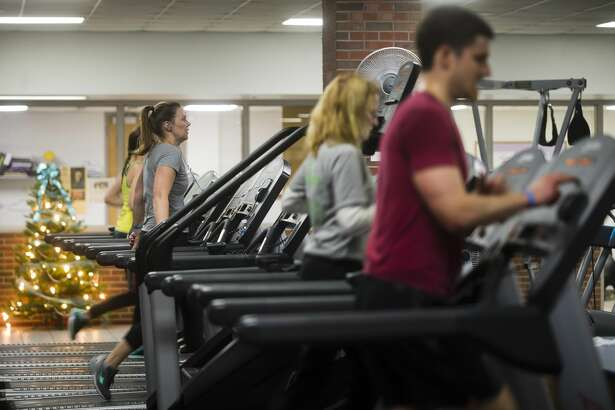 People work out in the wellness center inside the Greater Midland Community Center on Wednesday, Dec. 27, 2017. (Katy Kildee/kkildee@mdn.net)