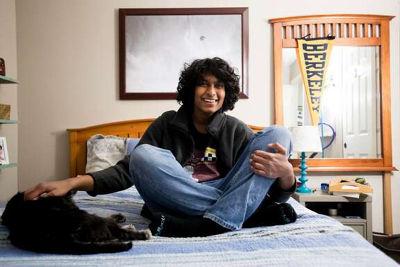Ajay Raja, who at 15 is the youngest University of California, Berkeley student, sits on his bed in Concord, Calif., on Friday, Dec. 22, 2017.