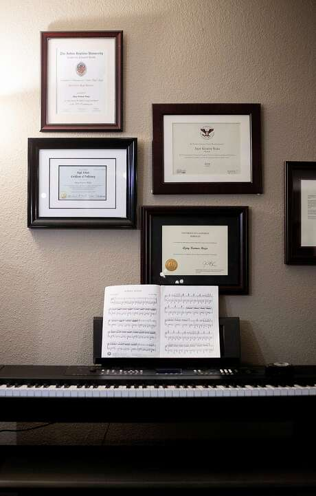 Certificates of achievement hang above Ajay Kumar Raja's keyboard on Friday, Dec. 22, 2017, in Concord, Calif. Raja, 15, is the youngest student at the University of California, Berkeley. Photo: Noah Berger, Special To The Chronicle
