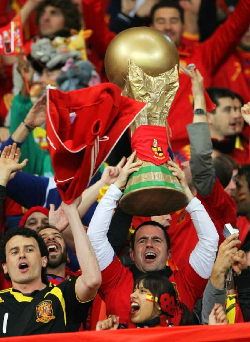 CAPE TOWN, SOUTH AFRICA - JUNE 29: Spain fans celebrate victory and progress to the quarter finals during the 2010 FIFA World Cup South Africa Round of Sixteen match between Spain and Portugal at Green Point Stadium on June 29, 2010 in Cape Town, South Africa. (Photo by Doug Pensinger/Getty Images)