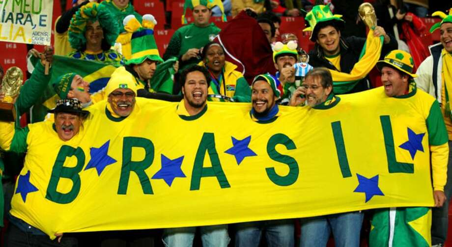 JOHANNESBURG, SOUTH AFRICA - JUNE 28:  Brazil fans enjoy the atmosphere ahead of the 2010 FIFA World Cup South Africa Round of Sixteen match between Brazil and Chile at Ellis Park Stadium on June 28, 2010 in Johannesburg, South Africa.  (Photo by Cameron Spencer/Getty Images) Photo: Cameron Spencer, Getty Images / 2010 Getty Images
