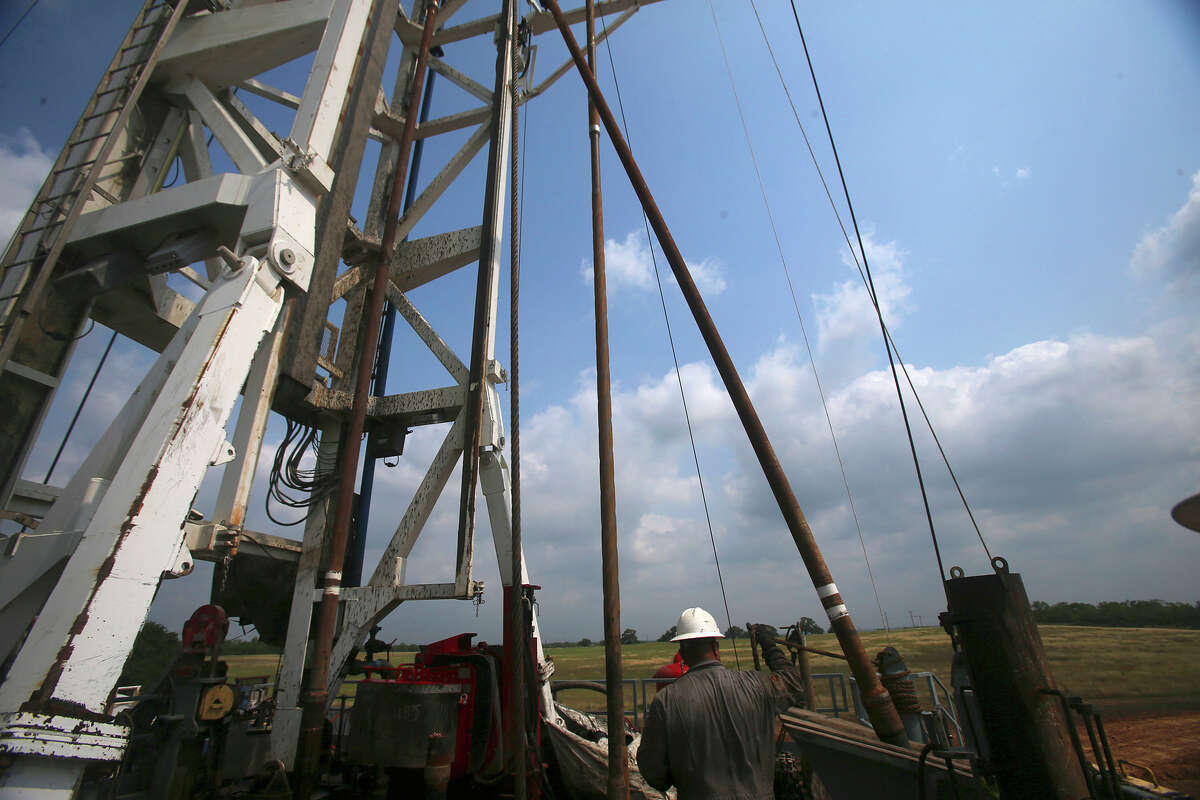 Roughneck Eluid (cq) Cervantes pulls up a section of drilling pipe with the help of machinery Thursday May 11, 2017 at the Abraxus Petroleum Shut Eye Unit oil drilling rig in the Eagle Ford Shale in Atascosa County, Texas. The rig will convert to a fracking well in July of 2017.
