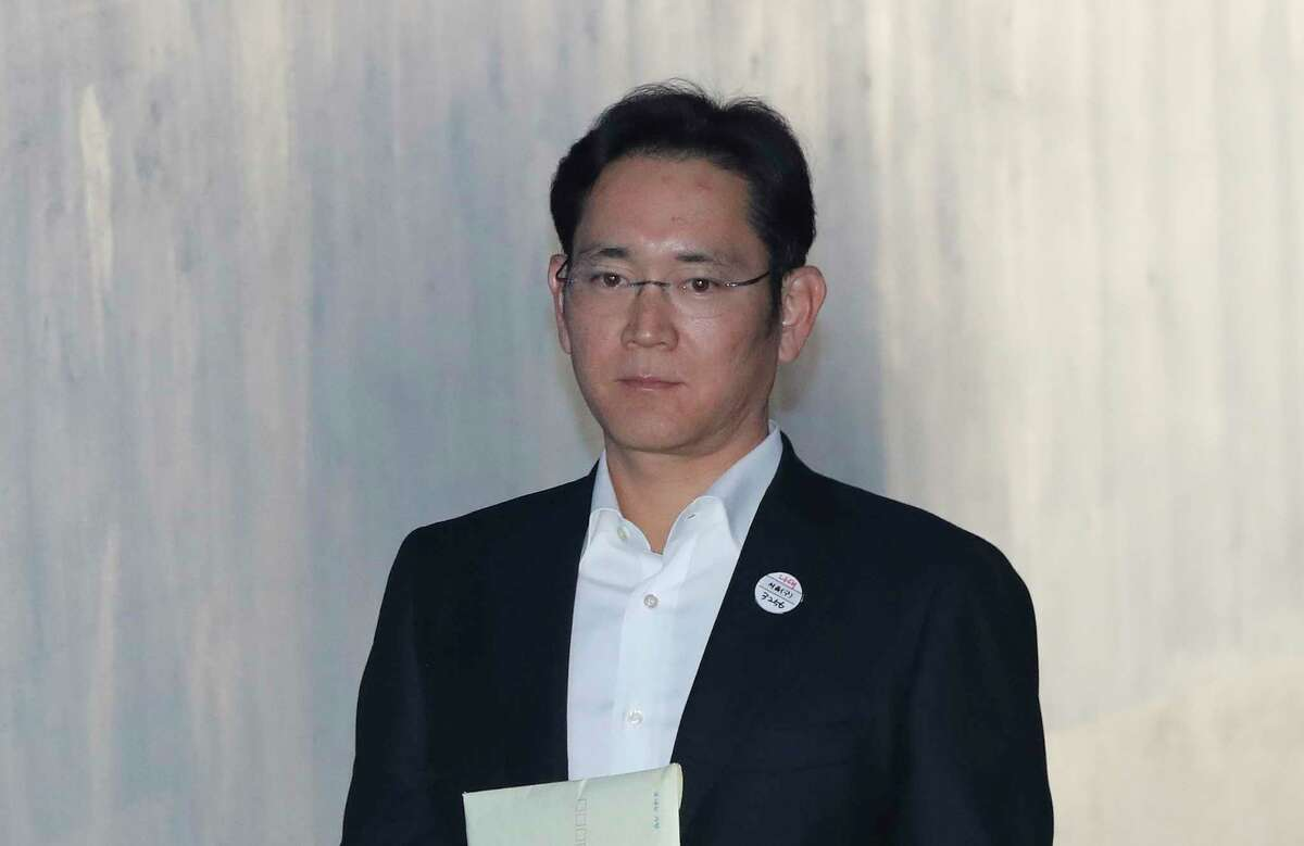 Lee Jae-yong, vice chairman of Samsung Electronics, arrives at the Seoul High Court in Seoul, South Korea, Wednesday, Dec. 27, 2017. Prosecutors are demanding a 12-year prison term for Lee for his conviction on bribery and other charge (AP Photo/Lee Jin-man)
