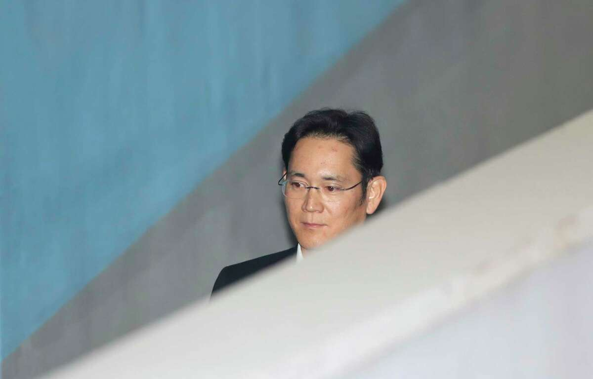 Lee Jae-yong, vice chairman of Samsung Electronics, arrives at the Seoul Hight Court in Seoul, South Korea, Wednesday, Dec. 27, 2017. Prosecutors are demanding a 12-year prison term for Lee for his conviction on bribery and other charge. (AP Photo/Lee Jin-man)