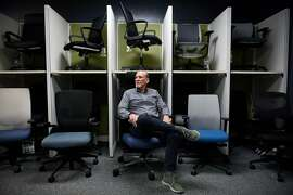 Give Something Back President Michael Hannigan sits for a portrait among office chairs sold by his company, at their offices in Oakland, Calif., on Wednesday December 27, 2017.