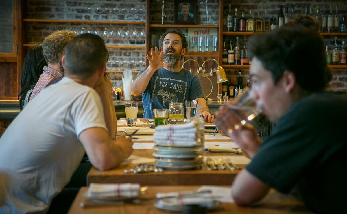 Chef Charlie Hallowell talks with the servers before service at Penrose in Oakland, Calif., on January 18th, 2014.
