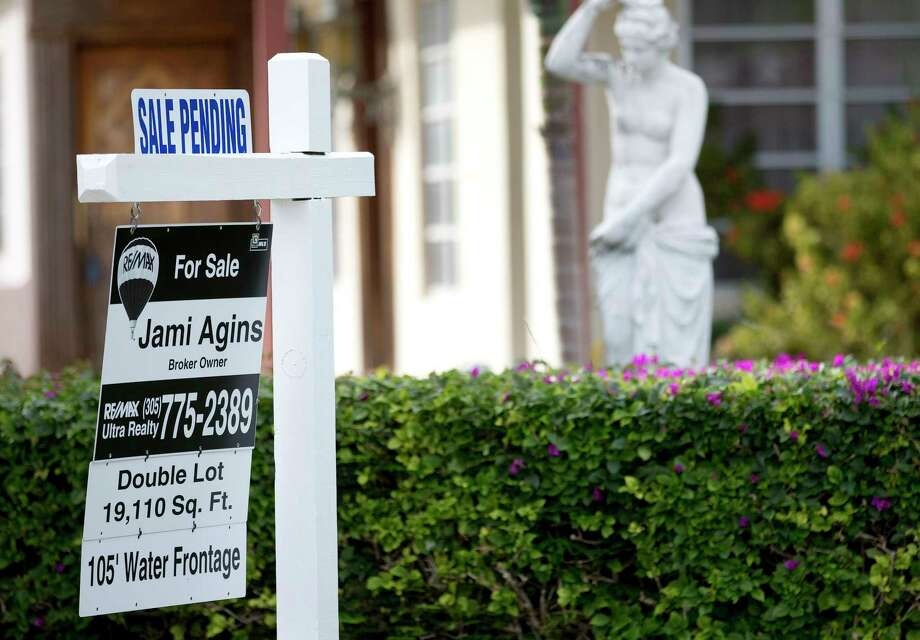 "FILE - In this Thursday, Jan. 8, 2015, file photo, a ""Sale Pending"" placard is placed atop a realty sign outside a home for sale in Surfside, Fla. On Wednesday, Dec. 27, 2017, the National Association of Realtors releases its November report on pending home sales, which are seen as a barometer of future purchases. (AP Photo/Wilfredo Lee, File) Photo: Wilfredo Lee / Copyright 2017 The Associated Press. All rights reserved."
