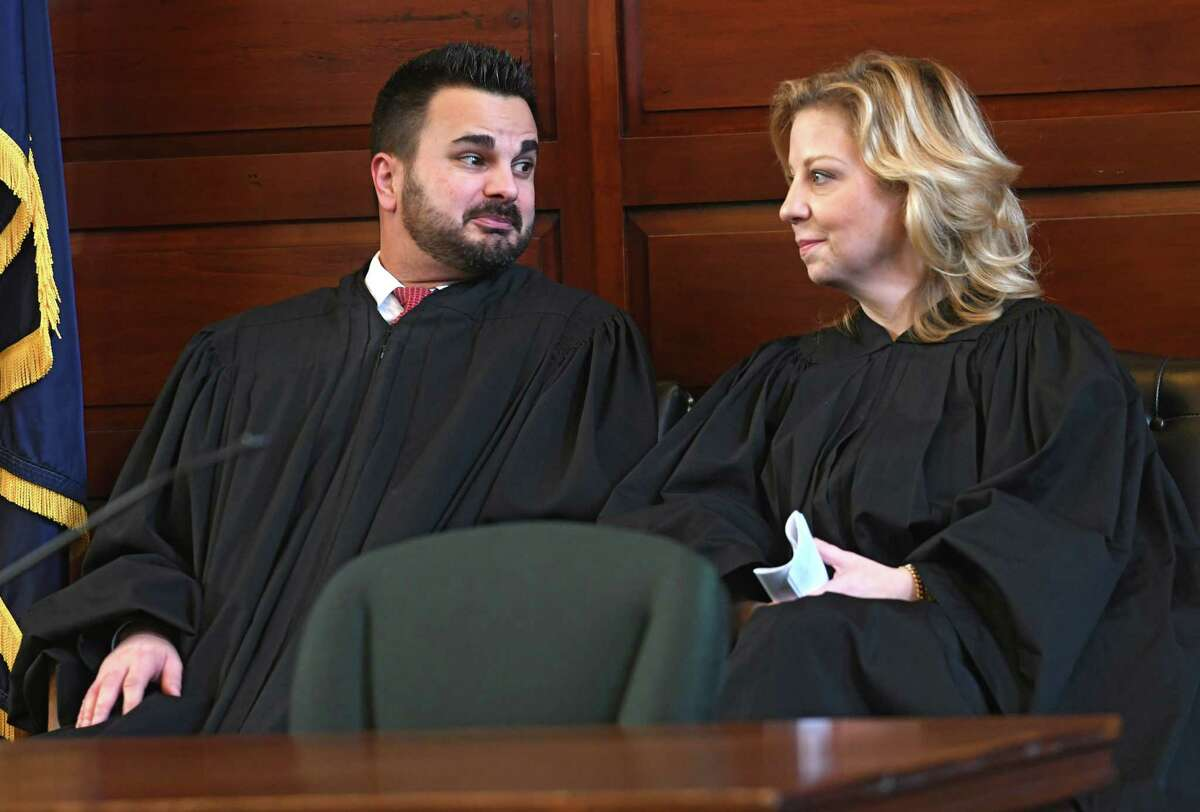Judge Andrew Ceresia, left, talks with Jennifer Sober of Schodack after delivering the oath of office to her as Rensselaer County Court judge in the Rensselaer County Court House on Wednesday, Dec. 27, 2017 in Troy, N.Y. She takes the spot vacated when Judge Andrew Ceresia was elected to State Supreme Court justice. Sober is one of four women holding county judgeships in Rensselaer County. (Lori Van Buren / Times Union)