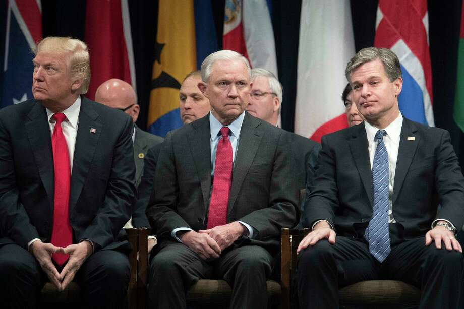 FILE-- From left, President Donald Trump, Attorney General Jeff Sessions and FBI Director Christopher Wray at an event at the FBI National Academy in Quantico, Va., Dec. 15, 2017. Nearly five months since Wray started the job, Trump has not made his life easier as the director seeks to restore the publicOs confidence in the countryOs premiere law enforcement agent - one that the president says is in Otatters.O (Tom Brenner/The New York Times) Photo: TOM BRENNER / NYTNS