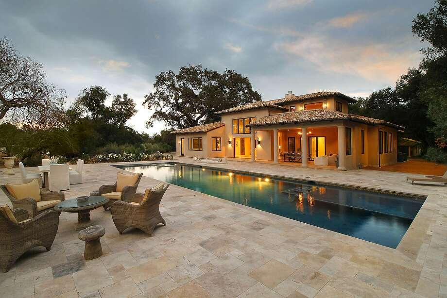 A tile terrace surrounds the 60-foot pool. Photo: Jack Journey