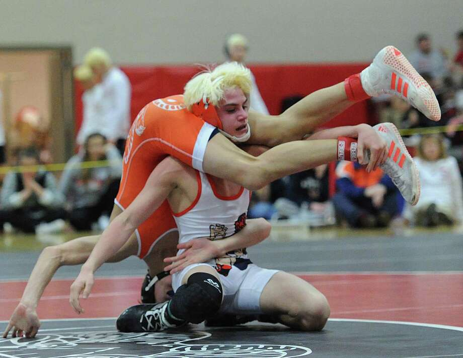 Ryan Jack of Danbury (in white) during the 106 pound champinship match that he won against Ridgefield's Ben Smart (in orange) during the FCIAC Wrestling Championships at New Canaan High School, Conn., Saturday, Feb. 11, 2017. Photo: Bob Luckey Jr. / Hearst Connecticut Media / Greenwich Time