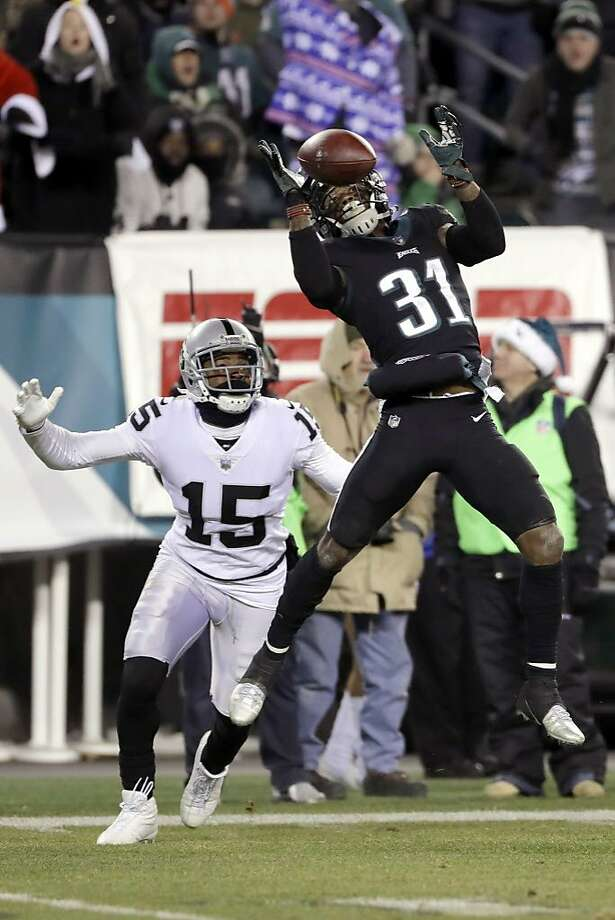 Philadelphia Eagles' Jalen Mills (31) breaks up a pass intended for Oakland Raiders' Michael Crabtree (15) during the second half of an NFL football game, Monday, Dec. 25, 2017, in Philadelphia. (AP Photo/Michael Perez) Photo: Michael Perez, Associated Press