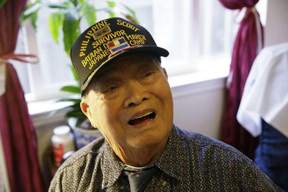 Bataan Death March survivor Ramon Regalado, a Philippine native born in 1917, reminisces at his home in El Cerrito. Photo: Eric Risberg, Associated Press