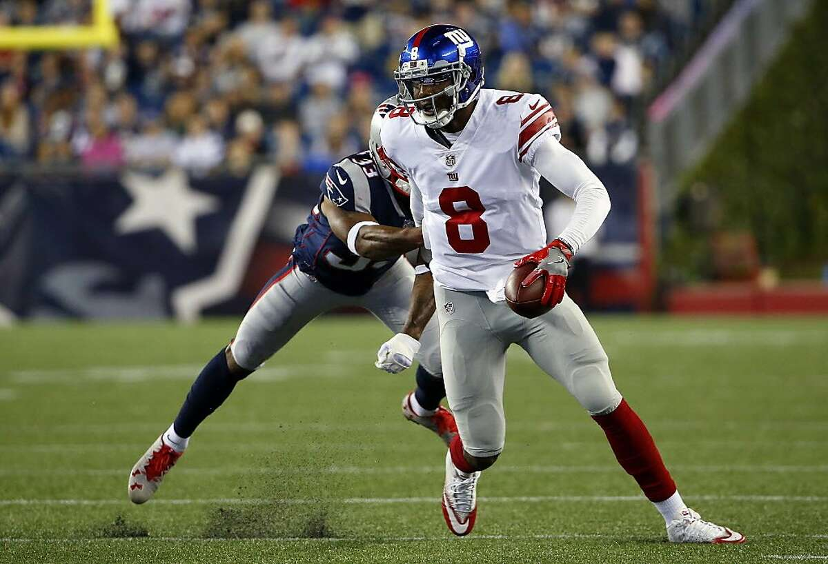 New York Giants quarterback Josh Johnson tries to scramble away from New England Patriots defensive back Will Likely, left, during the second half of an NFL preseason football game, Thursday, Aug. 31, 2017, in Foxborough, Mass. (AP Photo/Winslow Townson)