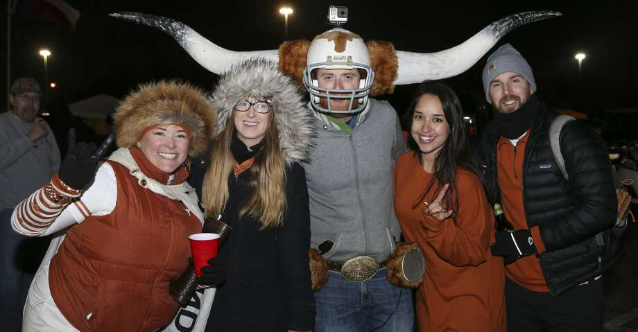 Texas and Missouri fans pose for a photo before the 2017 Academy Sports + Outdoors Texas Bowl at NRG Stadium on Wednesday, Dec. 27, 2017, in Houston. ( Yi-Chin Lee / Houston Chronicle ) Photo: Yi-Chin Lee/Houston Chronicle