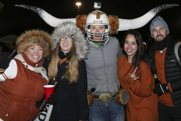 Texas and Missouri fans pose for a photo before the 2017 Academy Sports + Outdoors Texas Bowl at NRG Stadium on Wednesday, Dec. 27, 2017, in Houston. ( Yi-Chin Lee / Houston Chronicle )