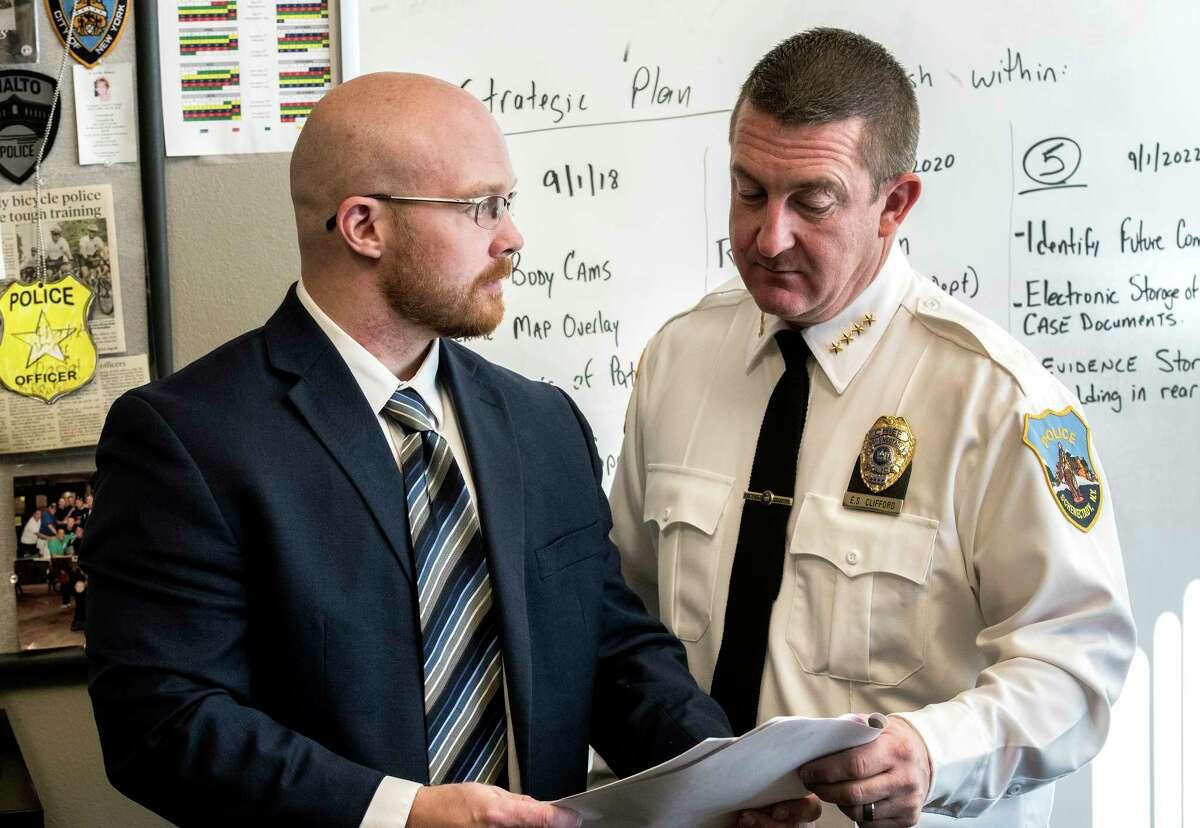 Criminalist Matthew Douglas speaks with Schenectady Chief of Police Eric Clifford at their offices on Thursday, Dec 21, 2017, in Schenectady, N.Y. (Skip Dickstein/ Times Union)